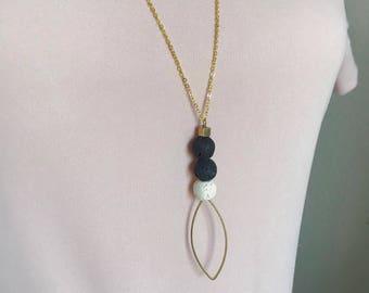 Black, white, gold geometric lava stone diffuser necklace