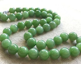 A Strand of Siberian apple green nephrite beads