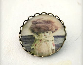 Photo Brooch of An Antique Doll Named Claudia Wearing A Fur Hat Bronze Pin