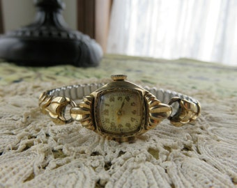 Vintage Bulova Working Woman's Gold-toned Watch with Comfortable Accordion-Style Wristband Swiss Made  #55