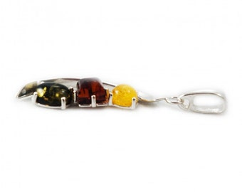 "Silver pendant with amber ""Play"""