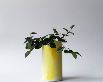 Yellow coloured concrete planter with marble effect
