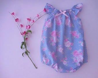 Sunsuit bubble romper playsuit for babies and toddlers in blue with white dots and pink flowers