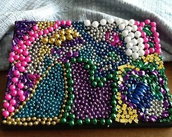 Handmade mosaic with broken Mardi Gras beads