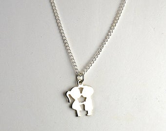Vintage Boy and Girl Silver Toned Necklace Pendant 1960s