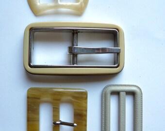 various old rectangular shaped plastic belt loops ivory or beige