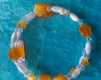 Orange memory wire  beaded bracelet
