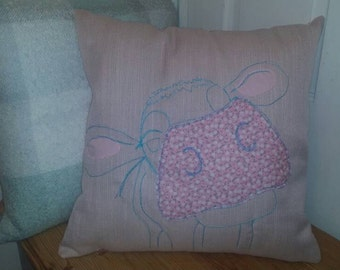 Lovely cow cushion in pink with floral touches.