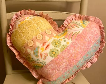 16 inch Heart shaped bohemian quilt pillow with ruffle in pinks and yellows and blues