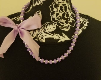 Purple beaded bow necklace