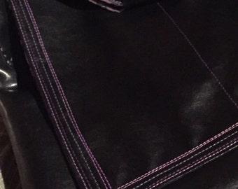 Black messenger bag with purple lining