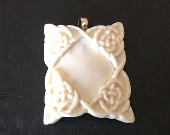Carved Bone Pendant with Sterling Silver Bail