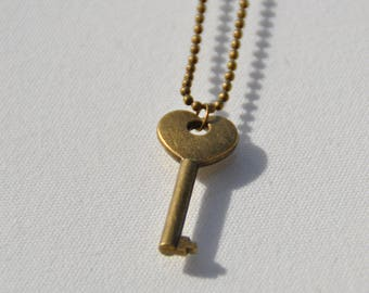 Bronze heart key necklace on a ball chain