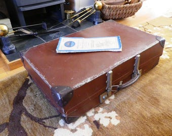 A 1940s Vintage Revelation brand large sized expanding suitcase in brown fibre made in England luggage travel prop