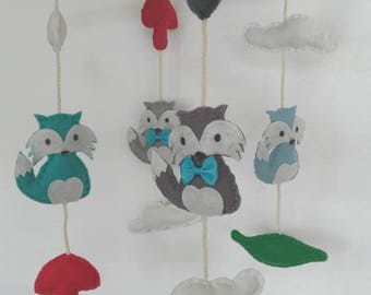 Driftwood mobile and its felt foxes