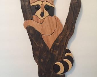 raccoon in a tree, wood art
