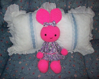Pink bunny stuffed animal, with multi color dress, Safe for ages 3 and up