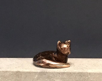 Laying down sleepy kitty made of real bronze. Relaxed cat with textured finish. Paired with my collection of cats. Miniature cat with style.
