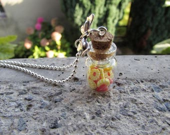 """""""Strawberry and pineapple"""" fruity vial necklace - with its slices of Strawberry and pineapple in polymer clay."""