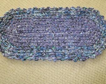 Crocheted purple, blue, black and white rag rug.   JW210