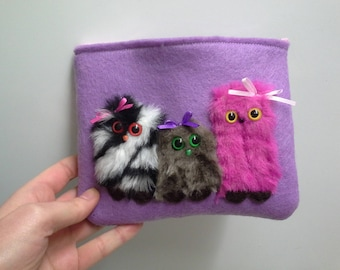 Makeup Pouch with a Zipper Three Little Furry Monsters
