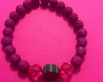Purple bead bracelet with charm