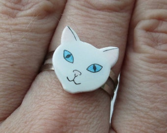 White cute cat/ kitten ring. Shrink plastic on an adjustable silver plated ring. Can be customized.