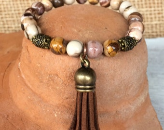 Tassel stretch yoga bracelet with brown zebra jasper gemstone and tibetan bronze beads with center brown suede tassel