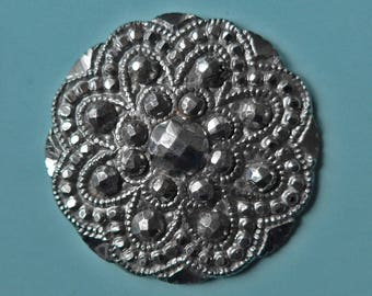 Cut steel button, antique.   A Court steel button, pressed steel with 9 cut steel rivets, steel loop shank.  19th. century.