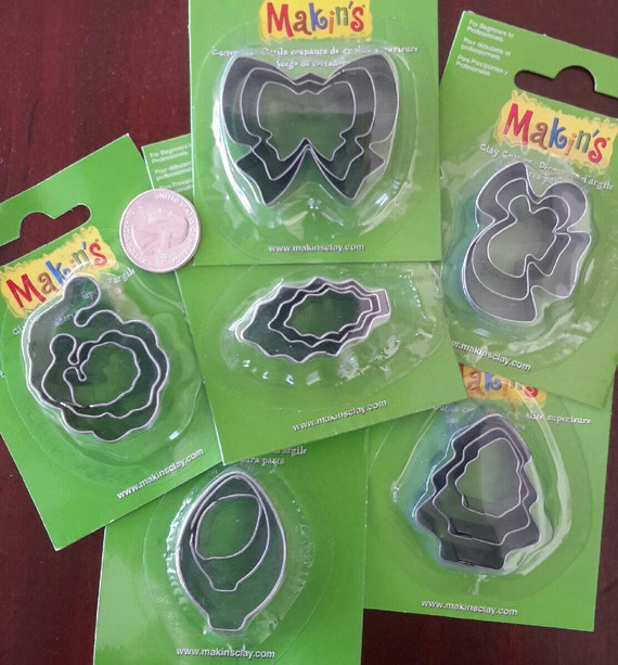 """30 piece holiday cookie cutter set with sizes from 7/8"""" to 1-3/4"""" tall"""