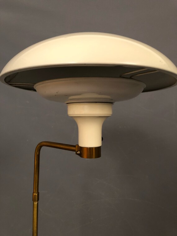 Gerald Thurston articulating saucer brass and enamel floor lamp for Lightolier.