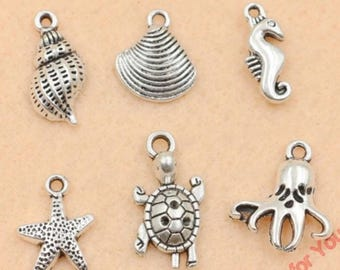 Sale!!18 pc lot sea life/ Beach charms Silvertone