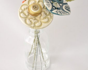 green, blue, and orange button flower bottle bouquet