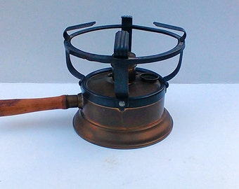A vintage brass alcohol heater