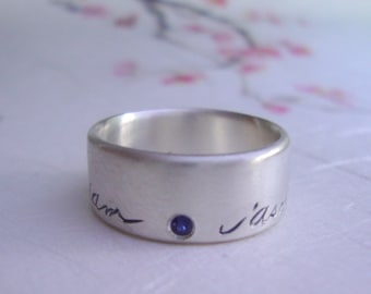 Custom family name ring in sterling silver with blue sapphire