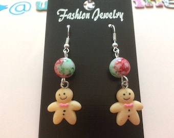 Gingerbread man novelty earrings with red and green bead