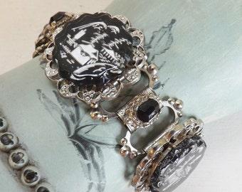 Vintage reverse carved glass link bracelet Asian theme pagoda scene intaglio silver tone with black rhinestones