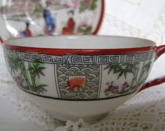 Mix and match Japanese Kutani hand painted cup and saucer - geisha saucer and cup with bamboo and a boat on stylised waves.