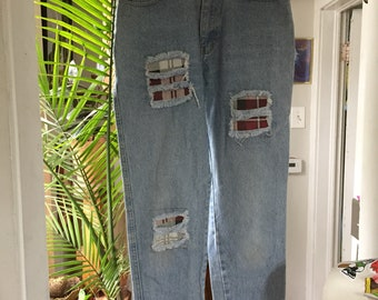 "Vintage High Waisted 80s/90s Light Wash Denim With Faux Flannel Patches and Distress By ""Traffic"" size 7/8"