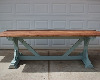 Trestle base dining table with stained top and Duck Egg green base
