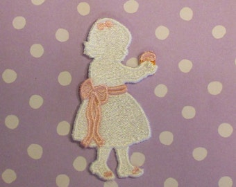 Delicate silhouette girl with cupcake