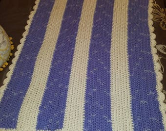 Beautiful crocheted purple and white baby blanket