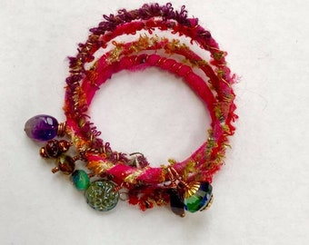Textile wrapped bracelet with gemstone dangles