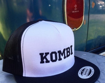 Volkswagen KOMBI Trucker Hat.  Structured front with embroidered Kombi design.  Mesh back with classic snap clasp.
