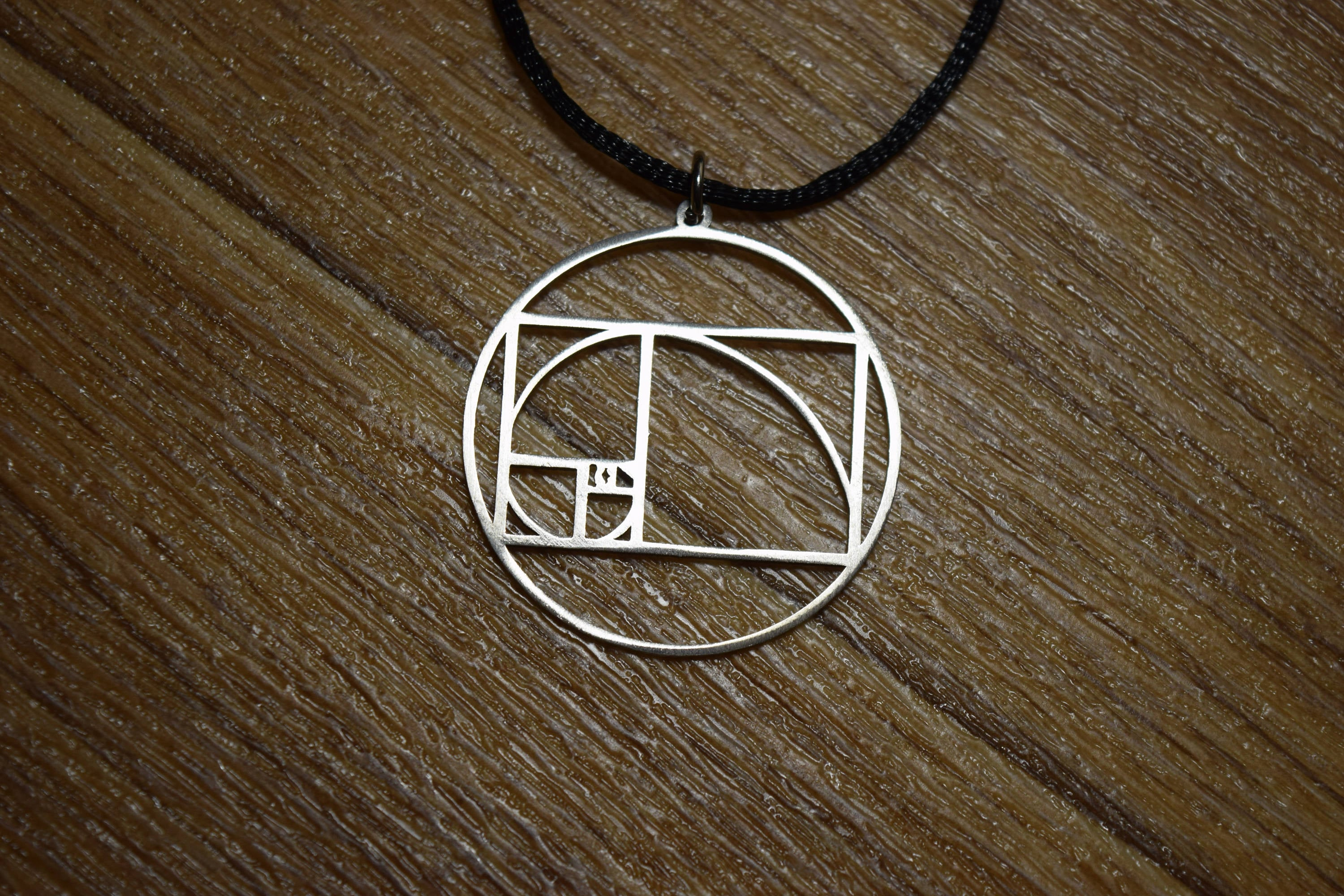 concrete product bar kaufmann corbelle studio cube original golden ratio necklace