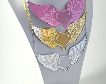 FREE HEART - Winged Heart Chest Piece Tattoo Style Charm Necklace - Laser Cut Acrylic In Gold, Silver, and Pink Mirror