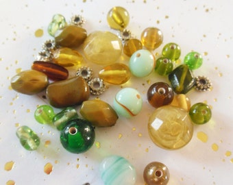 assortment of 30 glass beads and plastic