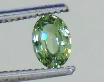 0.85 cts green sapphire faceted 5 x 7 mm oval Dry Creek, Montana