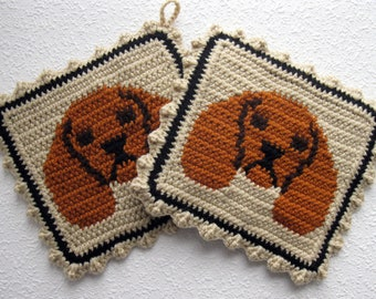 Cavalier Spaniel Pot Holders. Beige, crochet potholders with ruby cavalier spaniel dogs. King Charles cavalier spaniel gift