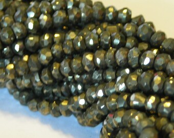 Pyrite faceted rondells half strand
